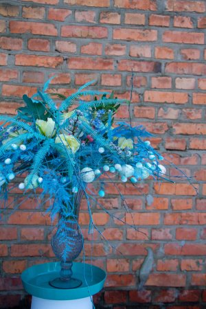 Photo for Stylish easter bouquet in blue tones over red brick wall background, selective focus, copy space - Royalty Free Image