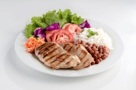 Dish with meat, rice and beans