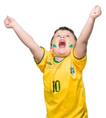 Small boy in brazilian national football shirt