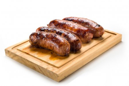 Sausage roasted on the grill, isolated on white ba...