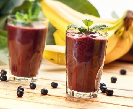 Photo for Acai Juice, super fruit smoothie, on wooden table - Royalty Free Image
