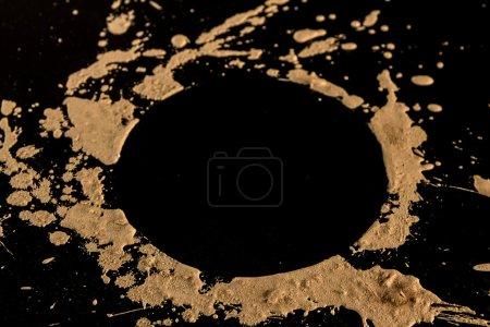 Splash of clay on black