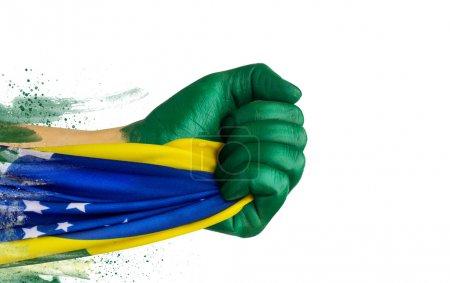 Photo pour Patriote de fan brésilien avec drapeau - image libre de droit