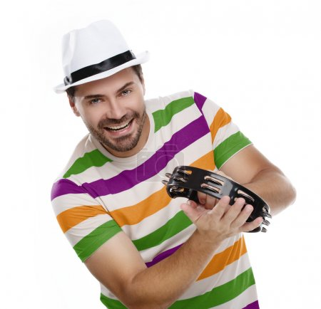 Happy man in colorful shirt with tambourine