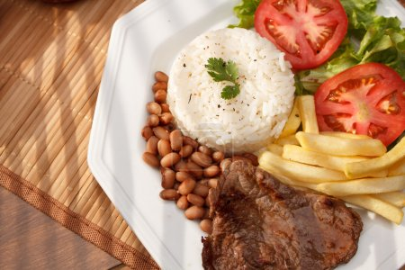 Typical dish of Brazil, meat, rice and beans...