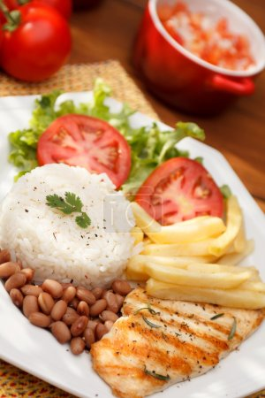 Photo for Typical dish of Brazil, meat, rice and beans - Royalty Free Image