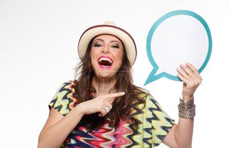 Beautiful woman holding speech bubble
