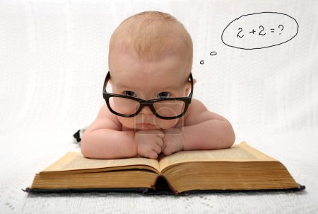 Photo for Portrait of adorable baby in glasses counting in mind with handwritten thought tag with case study - Royalty Free Image