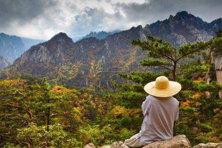 Buddhist monk meditating at seorak mountains