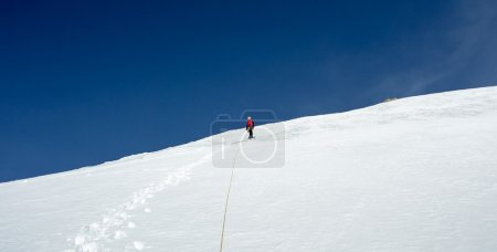 climber at the mountain summit in Kyrgyzstan