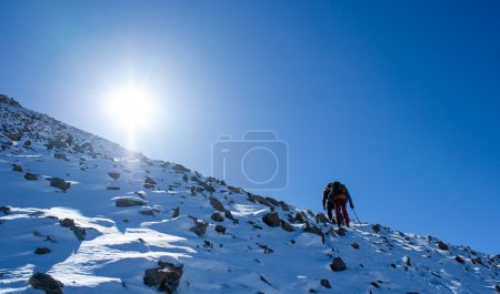 climbers at the mountain summit in Kyrgyzstan