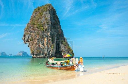 RAILAY, THAILAND - MARCH 19, 2014: Tourist merchant long tail bo