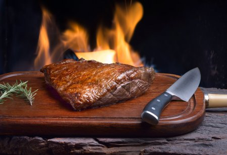 Photo for Roast picanha on wooden board, brazilian barbecue - Royalty Free Image
