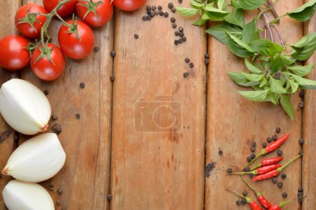 Photo for Preparation of Italian food on wood - tomatoes, basil, pepper. - Royalty Free Image