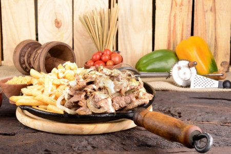 Sirloin Steak, Onions and French Fries Topped With...