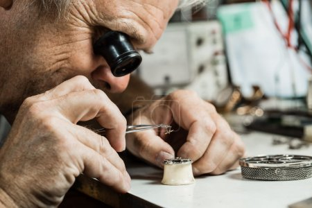 Clockmaker repairing wrist watch