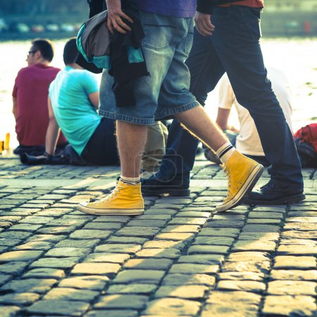 men walking on vintage stones