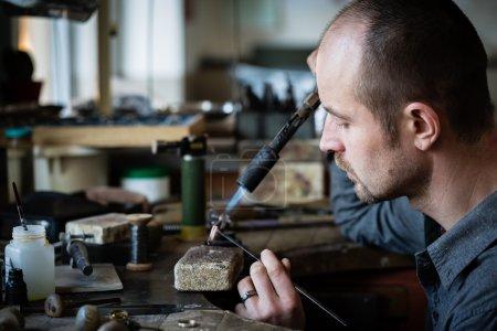 Jeweler working on ring