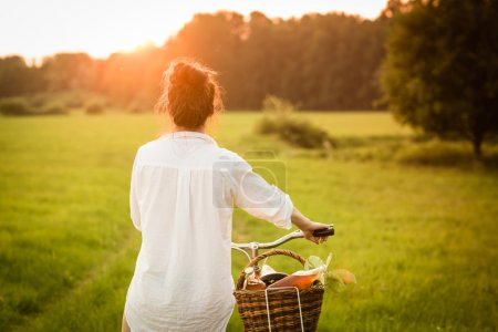 Woman riding bicycle with the basket