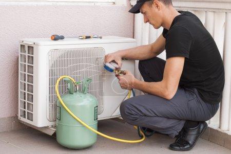 Master of repair air conditioners at work...