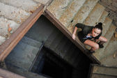 Girl near the brick wall in military style. Lara Croft style.