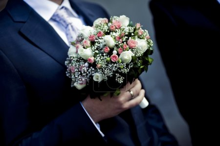 Groom or Row of bridesmaids with bouquets at big wedding ceremony.