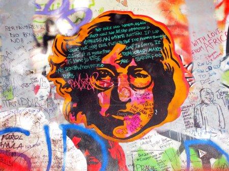 PRAGUE, CZECHIA - SEPTEMBER 25: John Lennon Wall on September 25, 2014 in Prague. Since the 80s the wall has been filled with John Lennon graffiti and John Lennon inspired lyrics from Beatles songs