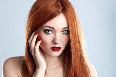 Photo for Fashion Beauty Model Woman Long Red Hair. Red Matte Lips and Nails. Blue Eyes. - Royalty Free Image
