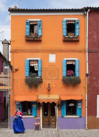 Burano, Italy - 21 May 2015: Brightly painted building. One of t