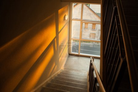 Staircase of apartment building with sunset light playing on the