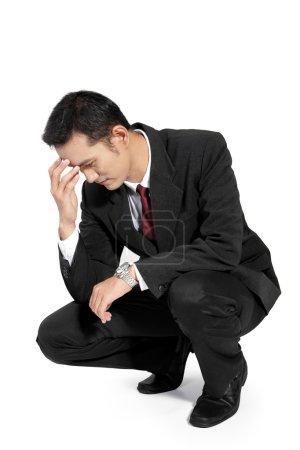 Businessman feeling down