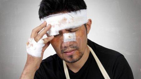 Injured man expressing head trauma concept