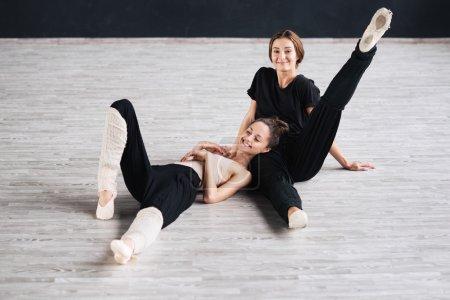 Two dancers friends practice in dance studio . pho...