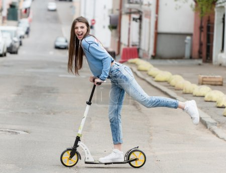 Photo for Girl on a skateboard scooter in the city - Royalty Free Image