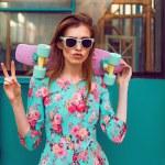 Beautiful hipster fashion young woman model posing...