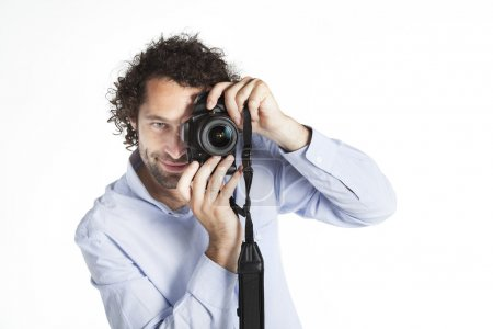 Young man taking a picture with reflex camera