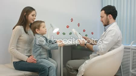 Pediatrician, mother and child atdoctor office