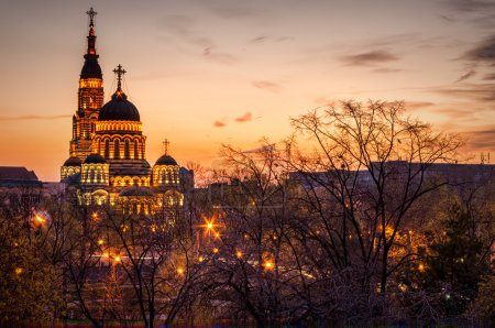 Cathedral church in Kharkiv, Ukraine at sunset wit...