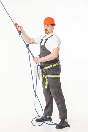 Industrial climber man isolated white studio...