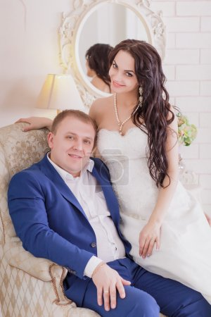 Bride and groom looking fondly of each other indoor