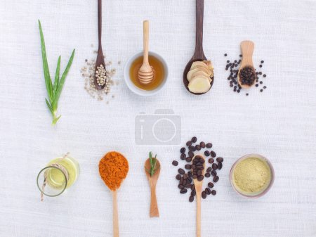 herb variety on rustic white background from top view, oil, coff