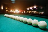 The russian billiards balls on the table in line