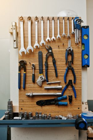 Group of used tools on wood deck, toolkit