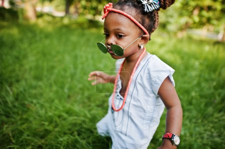 Amazing beautiful african american baby girl with sunglasses hav