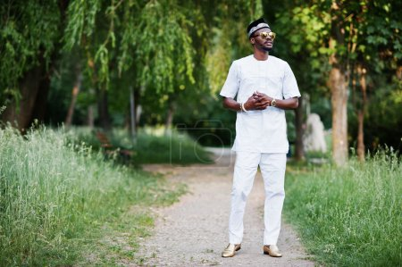 Portrait of stylish and rich black african american man on white