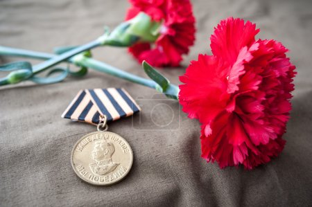 Medal For Victory over Germany in the Great Patriotic War of 1941-1945 and two red carnations