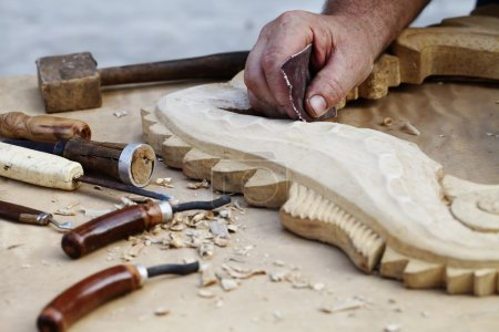 wood carvings, tools and processes work closeup
