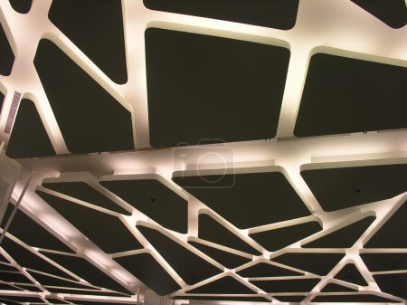 View of a suspended futuristic ceiling with modern lighting