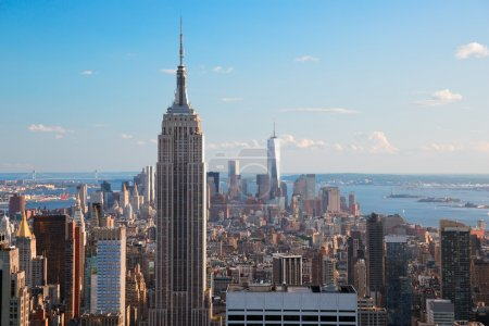 Photo for Amazing aerial view of Manhattan dominated by Empire State Building. Far is visible the Statue of Liberty - Royalty Free Image