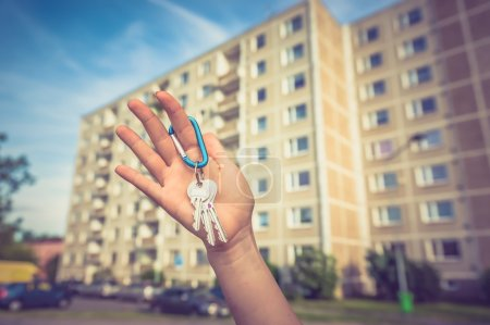 Real estate agent giving flat keys to a new proper...